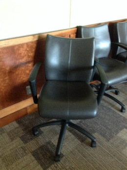 USED BROWN LEATHER CONFERENCE CHAIR
