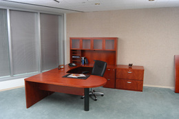 Desks, credenzas, tables for private off.